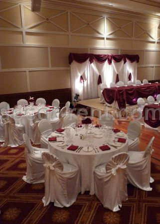 White and Burgundy Event Decor. (Rent Chair Covers Toronto)