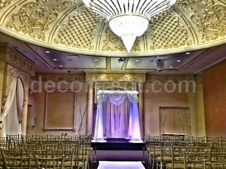 White chuppah with purple LED uplight projectors. Toronto.