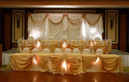 Custom Sheer Backdrop with Gold Satin Table Draping
