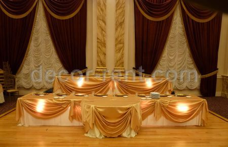 Gold Satin Table Draping with Spot Lights